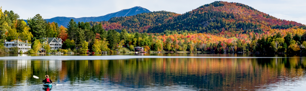 View of Mirror Lake in Lake Placid, New York, with a canoe