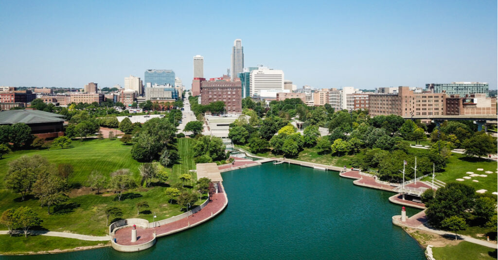 Aerial view of the Omaha Riverfront Trail and the Missouri River, with the Omaha, Nebraska, skyline in the background.