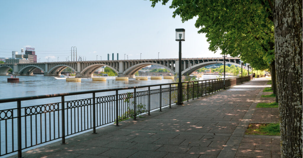 View of the West River Parkway along the Mississippi River in Minneapolis, with a bridge in the background.