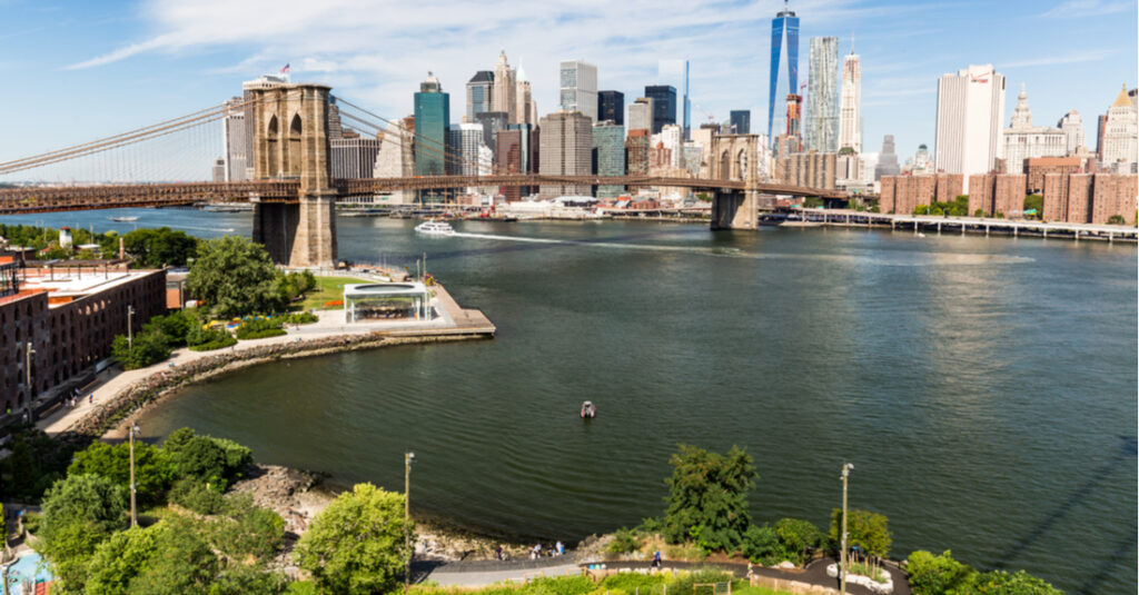 Aerial view of Brooklyn Bridge Park, with the East River, Brooklyn Bridge Park and downtown Manhattan in the background.